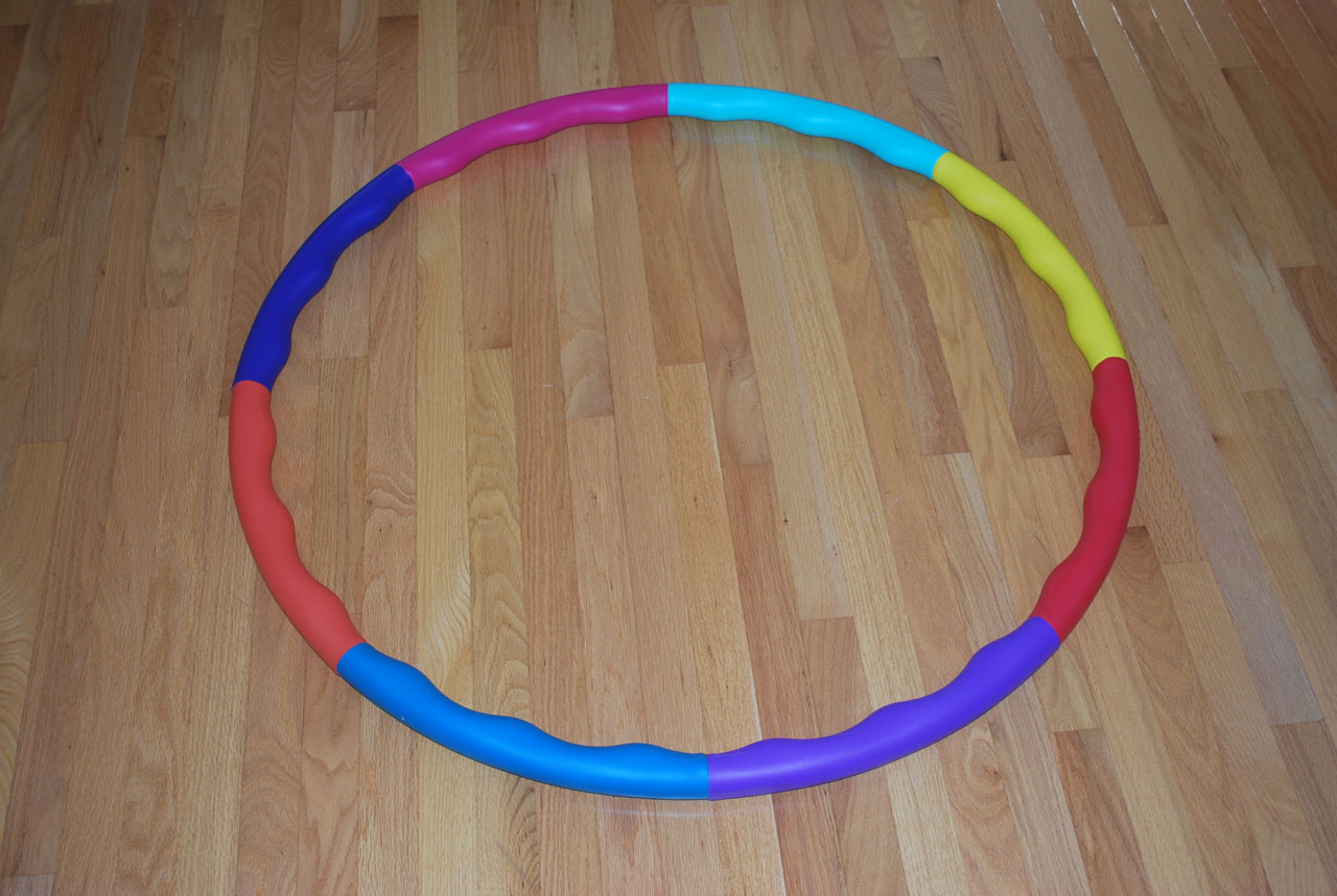A multicolored hula hoop.